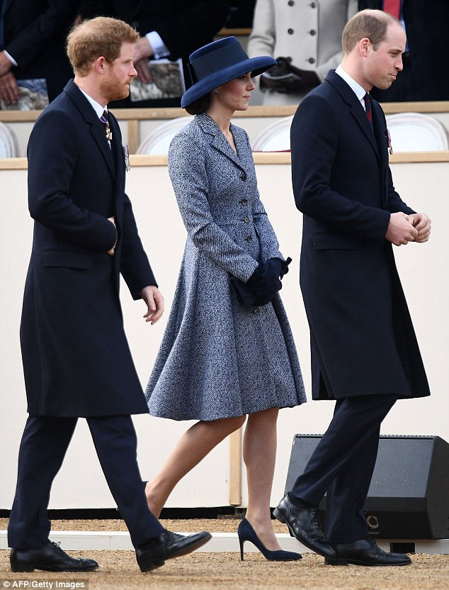 Kate recycled a Michael Kors coat for a Service of Commemoration and Drumhead Service on Horse Guards Parace, but wore a new navy hat by Lock & Co