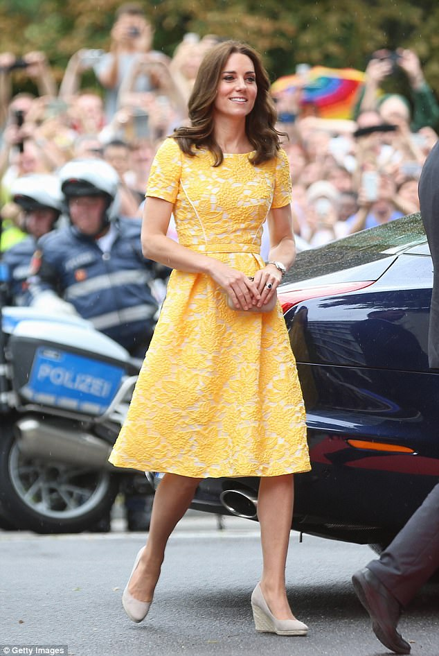 Mellow yellow: Kate donned a lemon-hued Jenny Packham frock - and sensible Monsoon wedges - as she embarked on a whistlestop tour of the town of Heidelberg on Thursday
