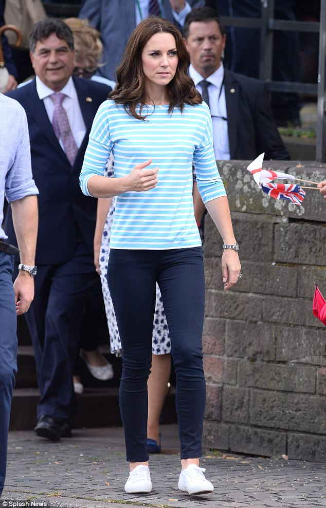 The Duchess cut a casual figure as she slipped into a sweater, jeans and trainers on Thursday for a boat race with William. Her Breton top was later revealed to be from Hugo Booss