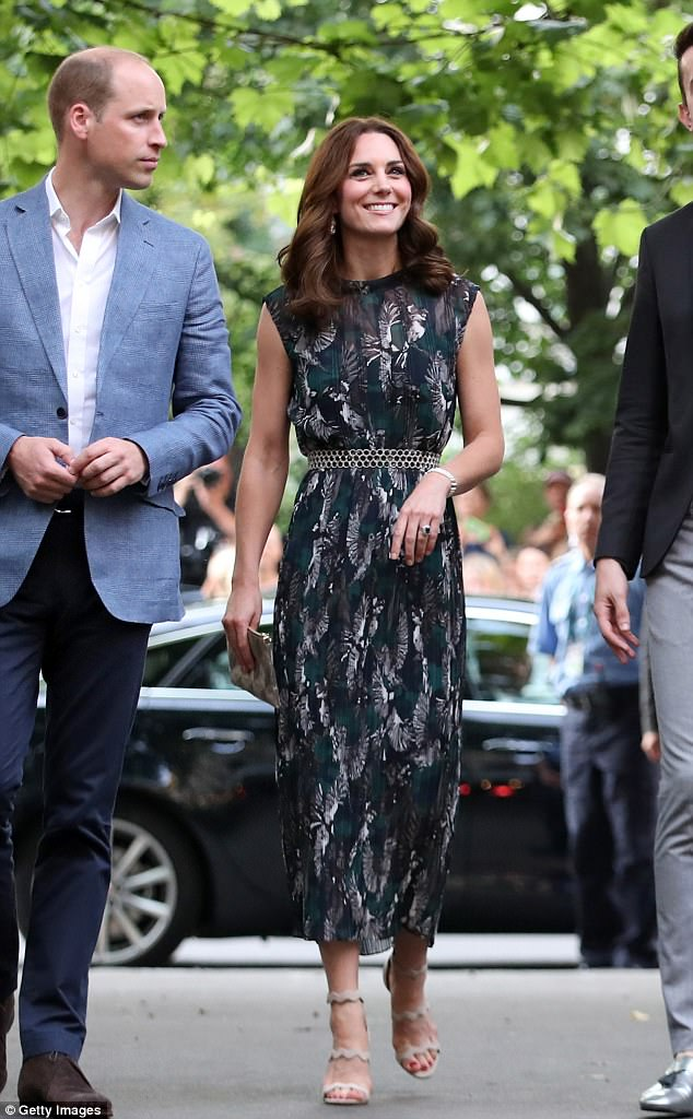 The Duchess donned a bottle green number for a reception at Berlin