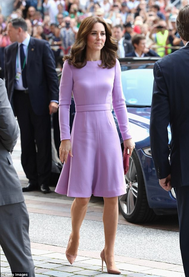 Kate was a vision in purple as she picked custom Emilia Wickstead for her final day in Germany - and even managed to navigate the tarmac at  Hamburg airport in her towering heels
