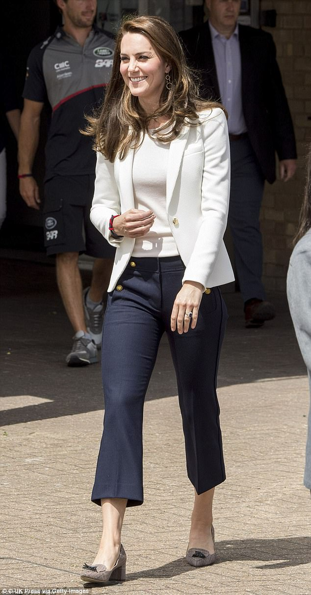 Kate, who stuck to the nautical colour scheme in skinny blue J Crew trousers, £103, as she visited the Docklands Sailing and Watersports Centre