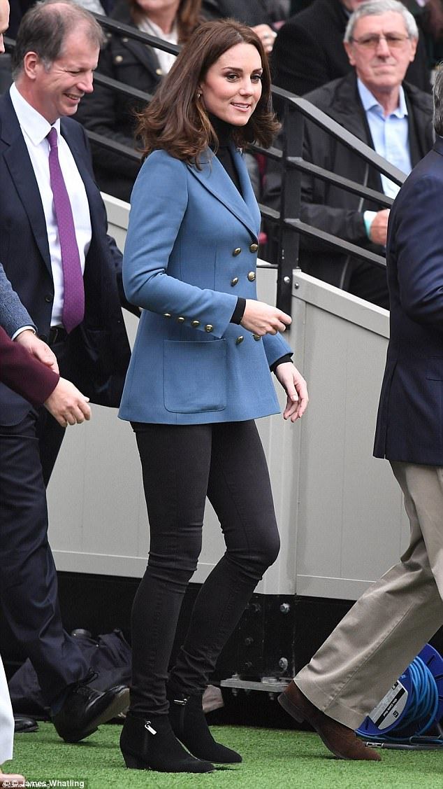 Kate covered up against the autumnal chill in a smart blue blazer by Philosophy Di Lorenzo Serafini on a visit to London Stadium
