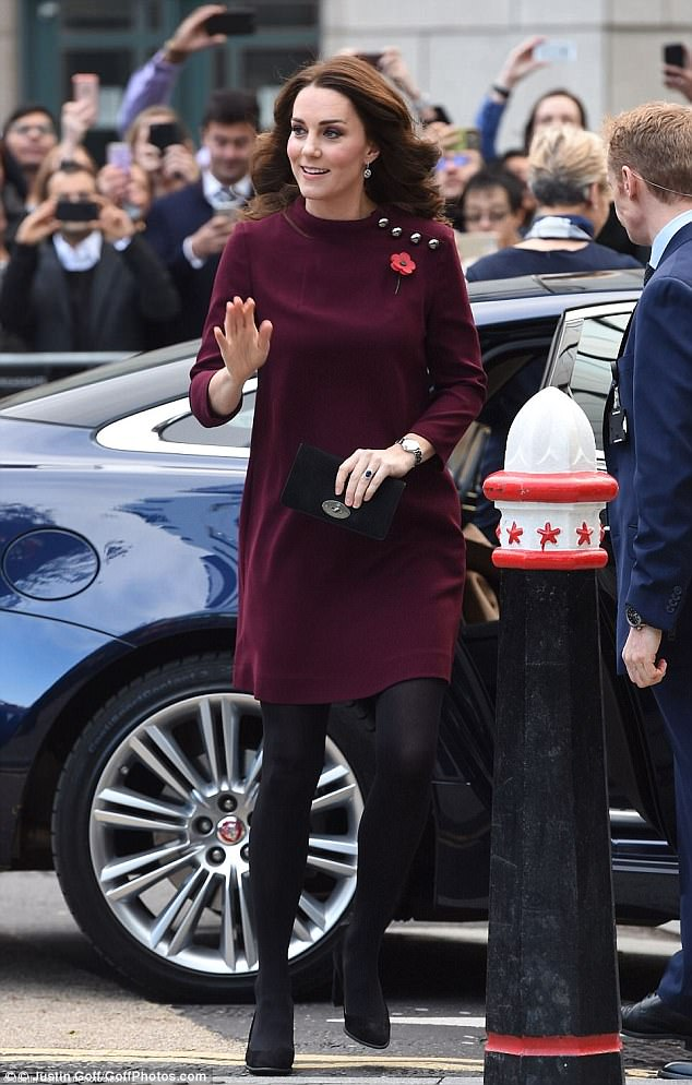 The expectant mother looked chic in a simple burgundy dress by Goat