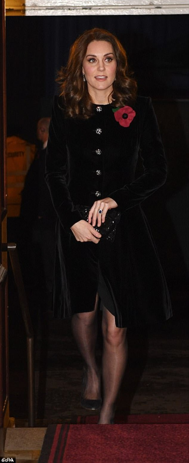 Kate looked elegant in a Catherine Walker coat dress with statement silver buttons