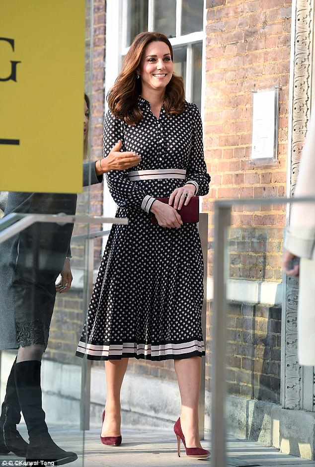 The pregnant mother-of-two displayed her neat baby bump in a figure-skimming Kate Spade dress, £350