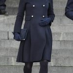 The pregnant mother-of-two, 35, looked understated but elegant in a £920 navy coat with silver buttons by Carolina Herrera
