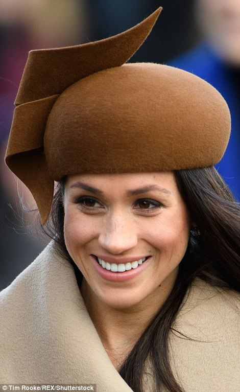 Meghan paired a striking brown beret with a beige coat which she tied up at the front to keep warm in the chilly Christmas Day teMeghan paired a striking brown beret with a beige coat which she tied up at the front to keep warm in the chilly Christmas Day temperaturesmperatures