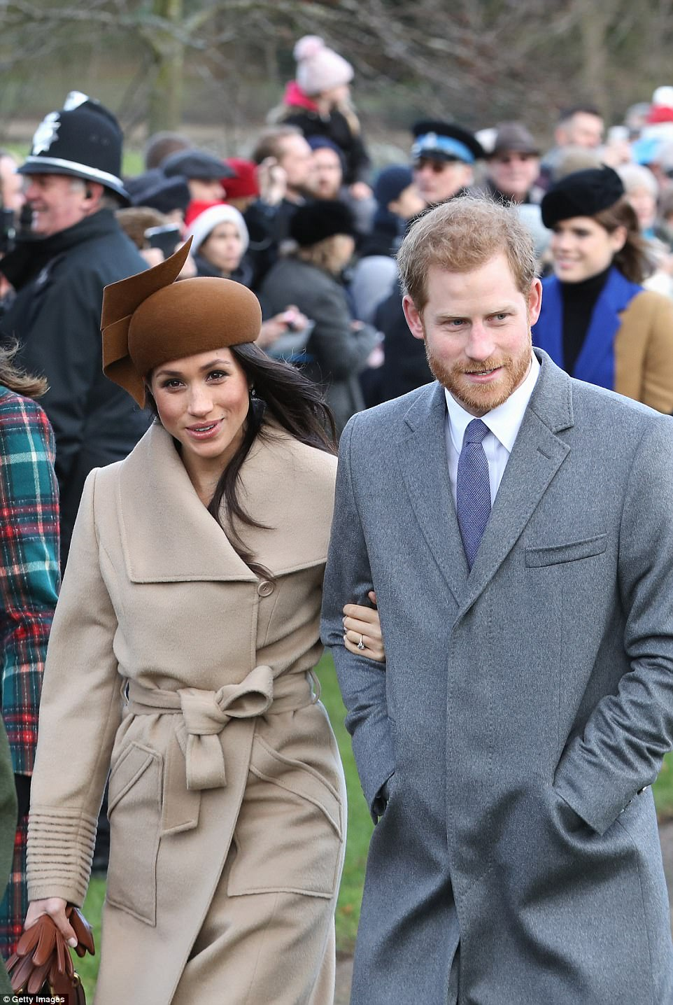 Meghan seemed at ease as she smiled and chatted with Prince Harry while clutching a pair of brown leather gloves in her spare hand