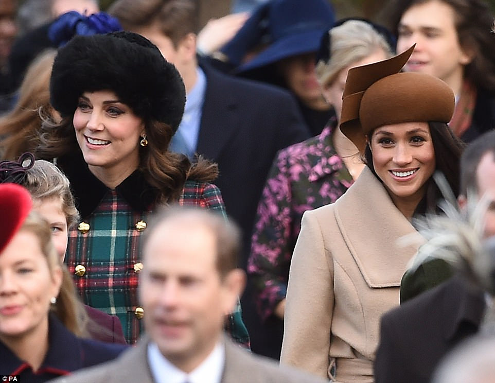 As Kate and Meghan walked side-by-side they flashed bright smiles at the waiting crowds