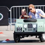 harry also took a moment to enjoy a spin in a tiny land rover driven by five year old daisy gommers during the games