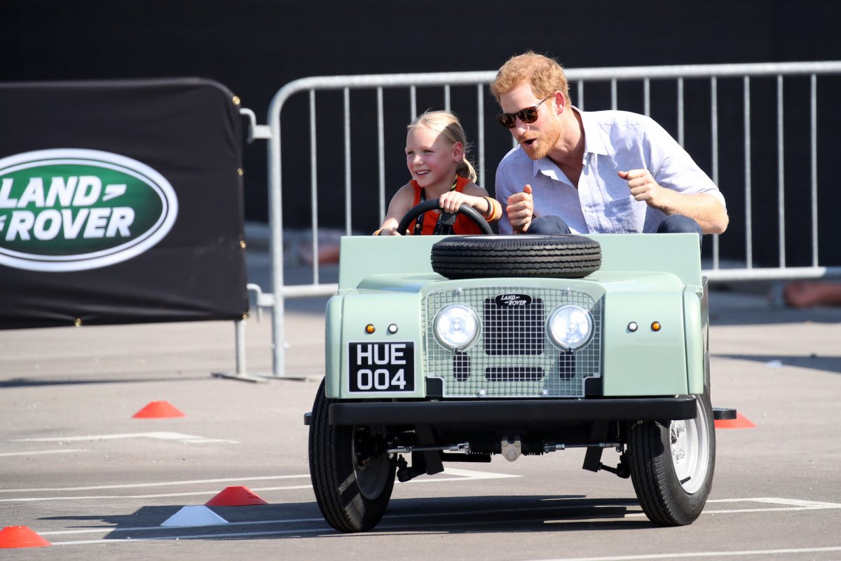 Harry also took a moment to enjoy a spin in a tiny Land Rover, driven by five-year-old Daisy Gommers, during the games.