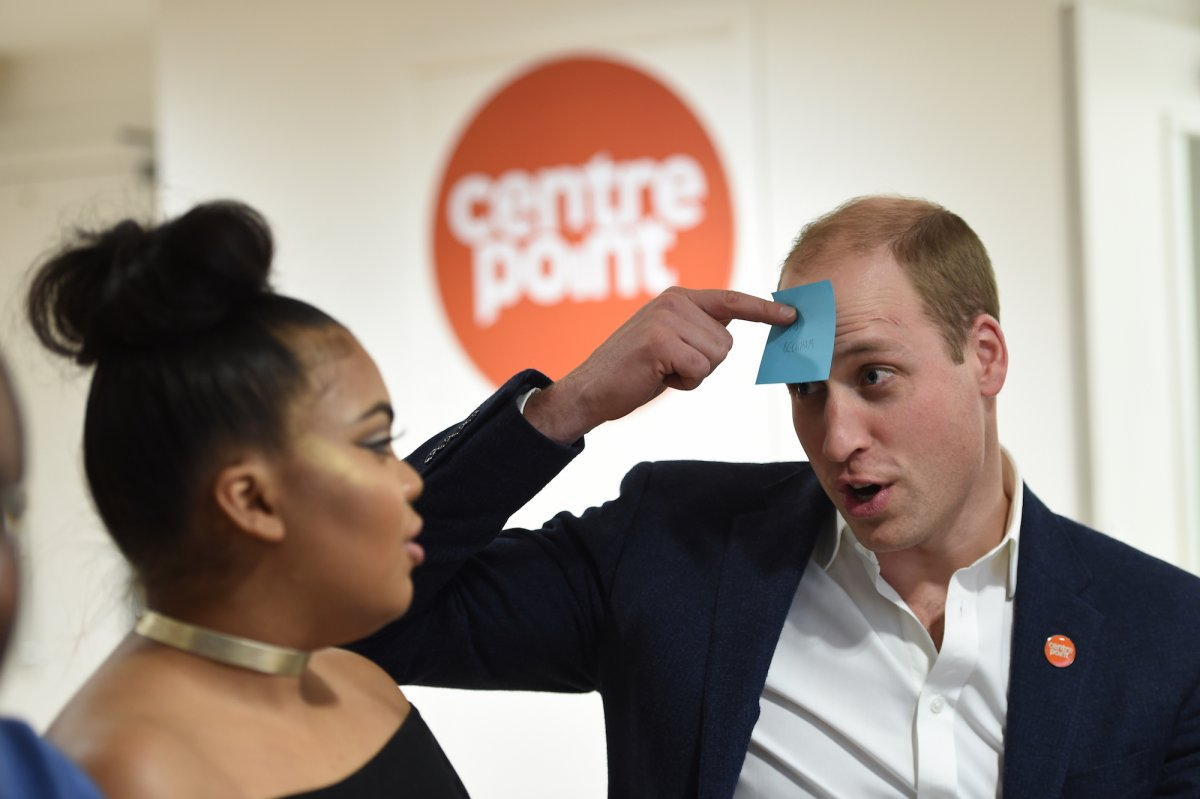 "In January Prince William made a solo venture to Centre Point, a homelessness charity in London. Here he plays a game with a young woman being helped by the charity (he has to guess the name on the note — which says ""David Beckham"")."