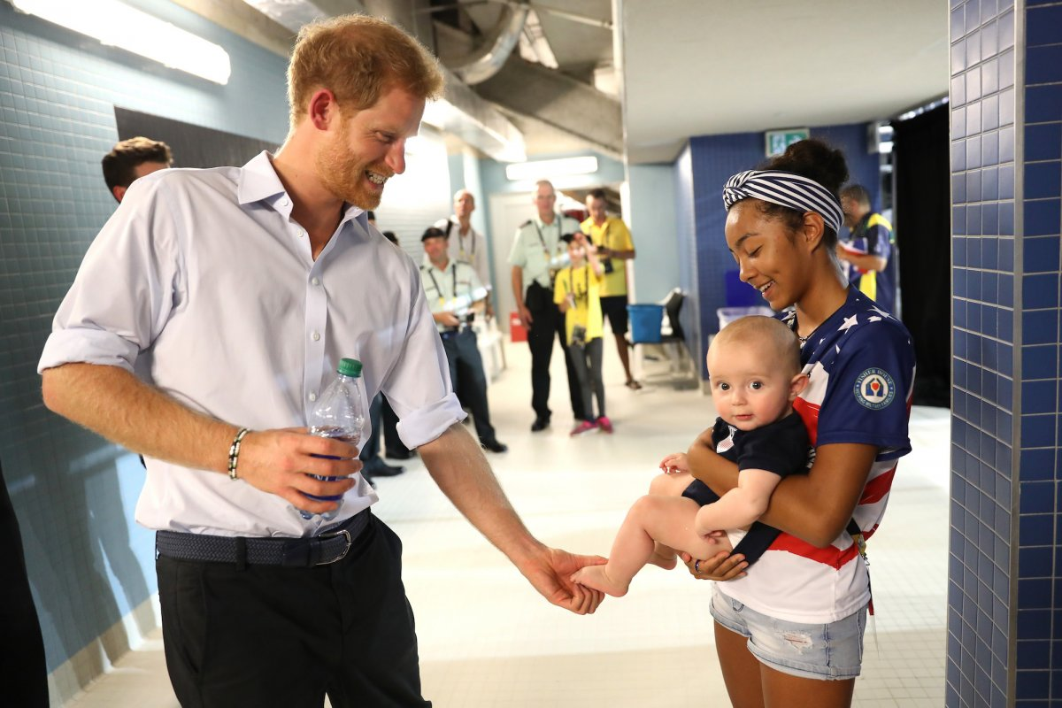 Later, he took time to hang out with this little guy behind the scenes of one Invictus event.