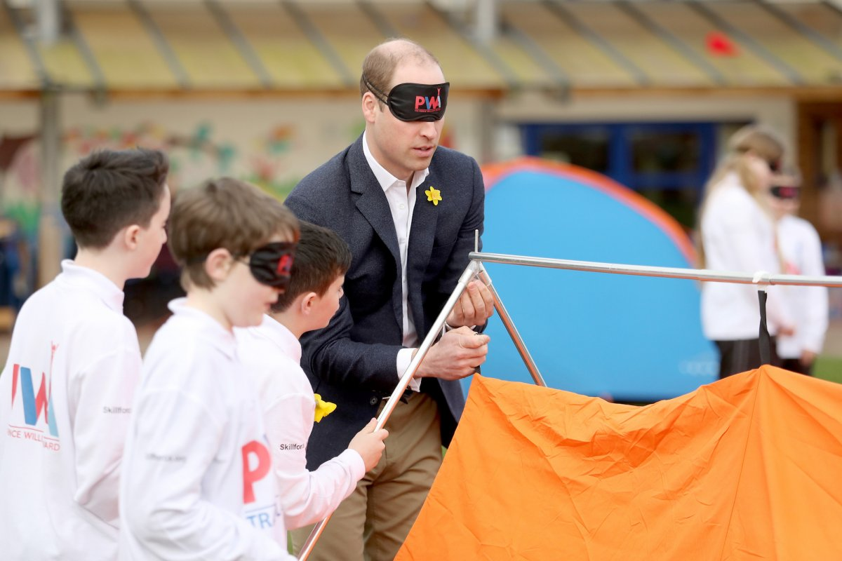 Prince William had more fun and games trying to put up a tent blindfolded in Abergevenny, Wales, while launching a children