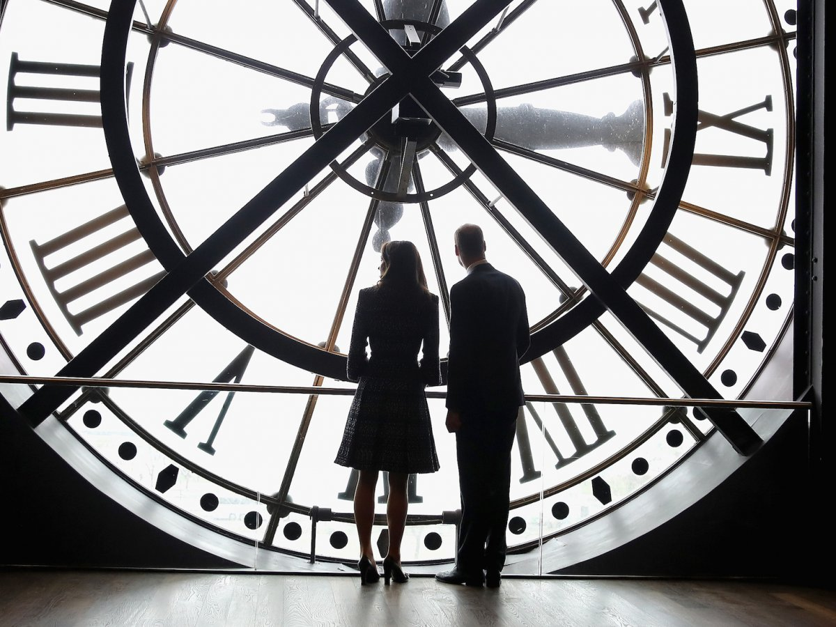 The next day, she and William were in Paris, and enjoyed a quiet moment looking out over Paris from behind the clock face of the city