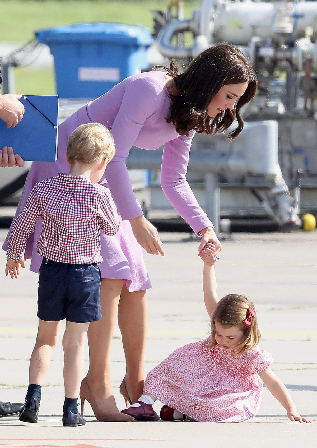 The trip was a bit too much for Princess Charlotte, who threw a minor tantrum on the runway before a helicopter ride.