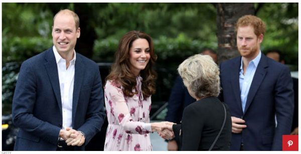 Kate Middleton, Prince William and Prince Harry meet a young guest outside the London Eye.