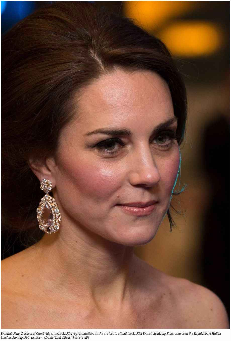 Britain's Kate Duchess of Cambridge meets BAFTA representatives as she arrives to attend the BAFTA British Academy Film
