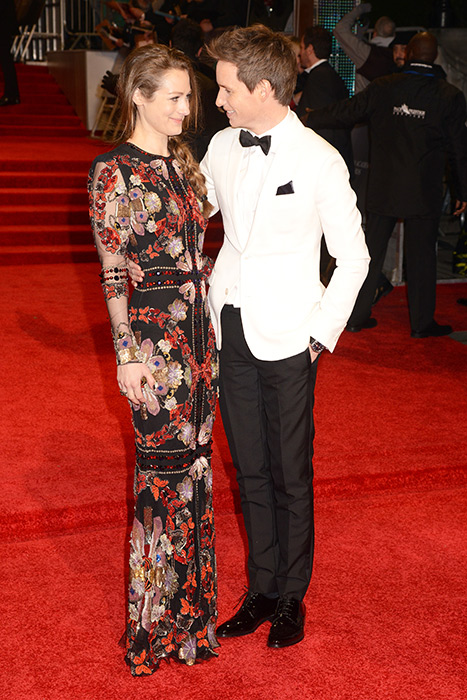 Eddie Redmayne and his wife Hannah Bagshawe caused quite a stir as they hit the red carpet at the 2017 BAFTAs. The couple looked very much in love as they posed together for the cameras, with Hannah turning heads in a striking black sheer gown with red detailing. Eddie and Hannah have been married since December 2014, and are parents to one little girl, Iris Mary, born in June 2016. Photo: © Getty Images Photo: © Getty Images