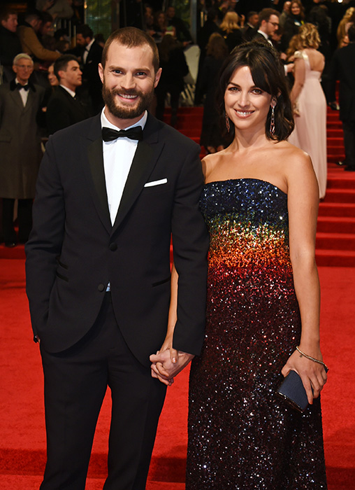 Fifty Shades of Grey actor Jamie Dornan proudly escorted his wife Amelia Warner to Sunday's ceremony. Jamie, 34, and 34-year-old Amelia, a singer and songwriter who performs under the name Slow Moving Millie, tied the knot in a country house in Somerset in April 2013, and have since welcomed two daughters together, Dulcie and Elva. Photo: © Getty Images Photo: © Getty Images