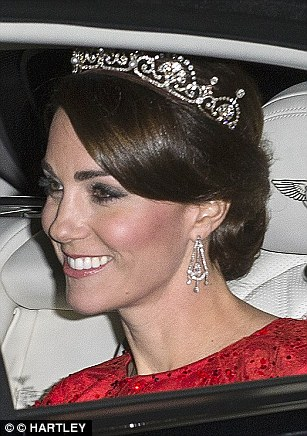 Kate donned the Lotus Flower with the Queen's borrowed chandelier earrings for the state banquet to