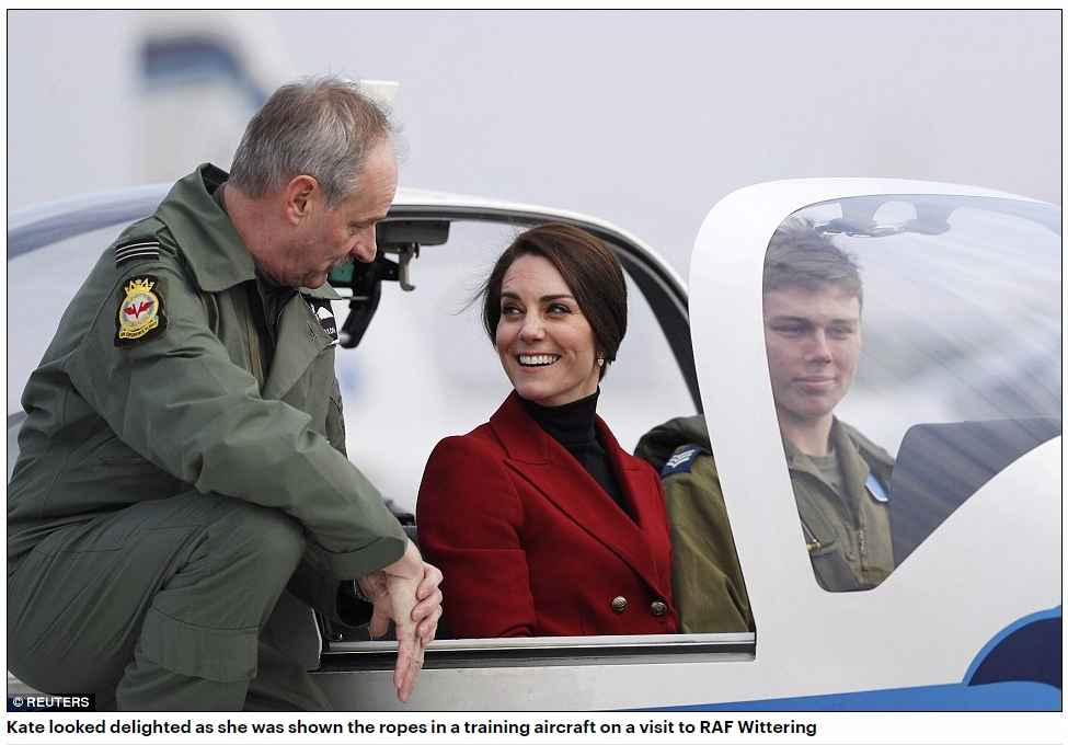 Kate looked delighted as she was shown the ropes in a training aircraft on a visit to RAF Wittering