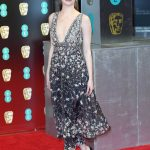 La La Land star Emma Stone dazzled in a plunging silver dress Photo C WIREIMAGE