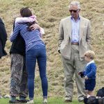 Prince George watches with The Duchess of Cambridge as Prince William plays polo with Prince Harry