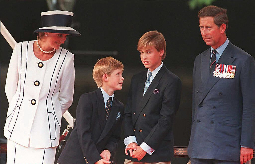 Princess Diana Harry and William and Prince Charles watch the parade march past as part of the commemorations of VJ Day. Photo C GETTY IMAGES