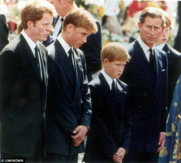 The young princes, their father Charles and Earl Spencer, Diana's brother (left) look on as Diana's coffin passes Photo (C) UNKNOWN