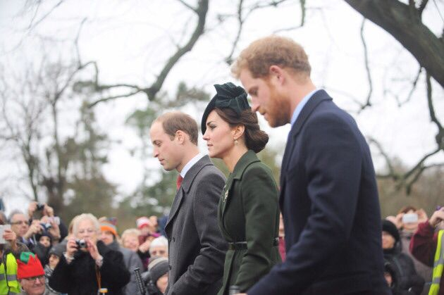 William, Kate and Harry walking to church on Christmas morning December 25, 2015 Photo (C) GETTY IMAGES
