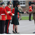 1 Kate Middleton is standing by her man—literally and figuratively