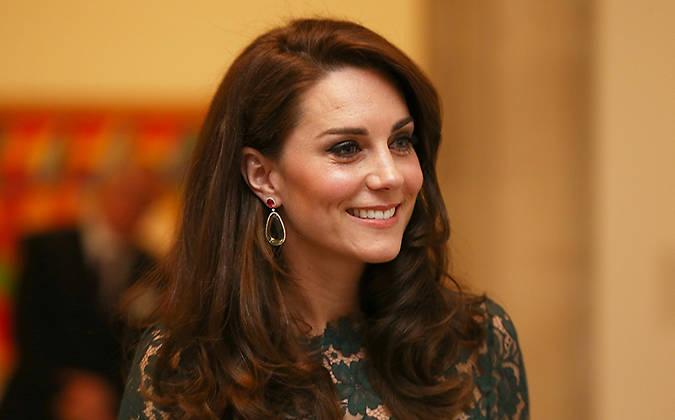 10 Catherine Duchess of Cambridge was dressed to impress wearing a floor length dark green Temperley dress that featured delicate lace detailing Photo C GETTY IMAGES