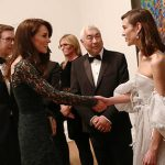 5 Catherine Duchess of Cambridge was dressed to impress wearing a floor length dark green Temperley dress that featured delicate lace detailing Photo C GETTY IMAGES