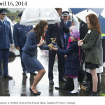 Being given a stuffed dog at the Royal New Zealand Police College.