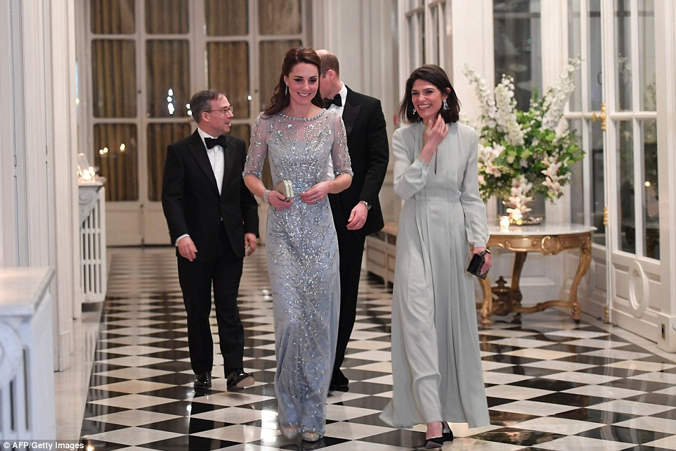British Ambassador Edward Llewellyn (left) and his wife walked with the Duke and Duchess of Cambridge before a diner at the British Embassy in Paris