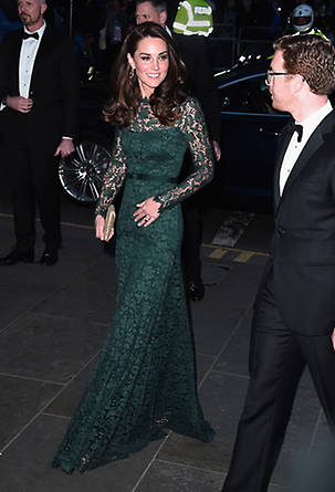 Kate paired her gown with a glitzy gold clutch, and wore her hair down in loose curls, with natural make-up to complete the look. Photo: © Getty Images