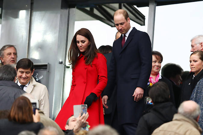 Kate wore her Carolina Herrera red coat to the Wales vs France rugby match. Photo (C) GETTY IMAGES