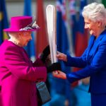 Louise Martin CBE President of the Commonwealth Games Federation presents the Baton to Her Majesty. Sgt Rupert Frere RLC MoD Crown