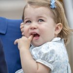 Not one to stand on ceremony Princess Charlotte decided to have a nibble on her own finger while taking in the view. Look at those choppers Image Via IAN JONES ALLPIX SPLASHNEWS
