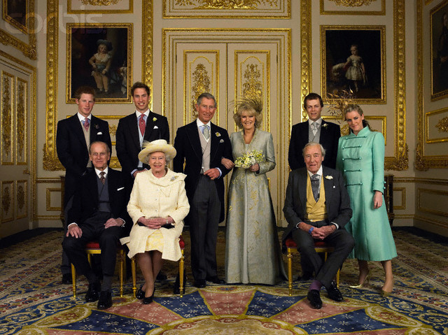 09 Apr 2005, Windsor, Berkshire, England, UK --- Prince Charles, the Prince of Wales and his new bride Camilla, Duchess of Cornwall, with their families. From left to right, back row: Prince Harry, Prince William, Tom and Laura Parker-Bowles, front row: Prince Philip, Queen Elizabeth II and Camilla's father Major Bruce Shand, in the White Drawing Room at Windsor Castle. --- Image by © Pool Photograph/Corbis