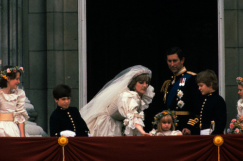 29 Jul 1981, London, England, UK --- Prince Charles looks happy and his new bride, Lady Diana, The Princess of Wales, looks radiant following their royal wedding in London. They stand on a balcony at Buckingham Palace where they are joined by children of the royal family. --- Image by © Wally McNamee/CORBIS