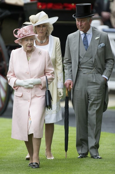Britain's Queen Elizabeth II, with Prince Charles and his wife with Camilla, Duchess of Cornwall walk in the parade ring on the first day of the Royal Ascot horse race meeting in Ascot, England, Tuesday, June 18, 2013. (AP Photo/Alastair Grant)