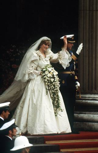 The Prince and Princess of Wales leave St Paul's Cathedral after their wedding, 29th July 1981. She wears a wedding dress by David and Elizabeth Emmanuel and the Spencer family tiara. (Photo by Jayne Fincher/Princess Diana Archive/Getty Images)