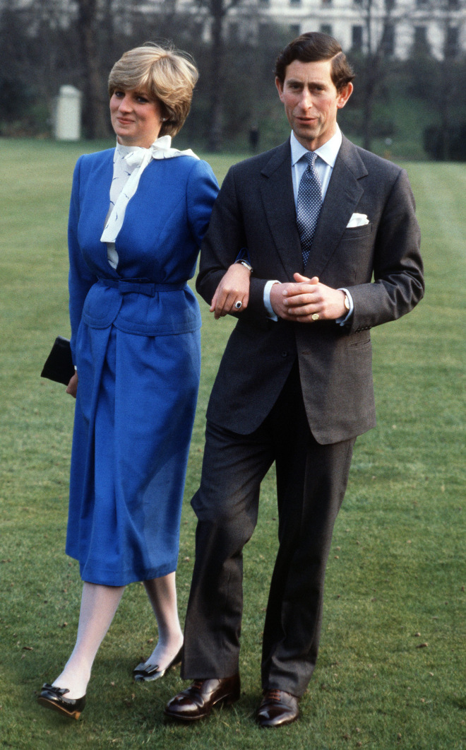 LONDON, UNITED KINGDOM - FEBRUARY 24: Lady Diana Spencer With Prince Charles In The Gardens Of Buckingham Palace On The Day They Announced Their Engagement. ++ Dress Reported As Designed By Cojana And Bought From Harrods (Photo by Tim Graham/Getty Images)