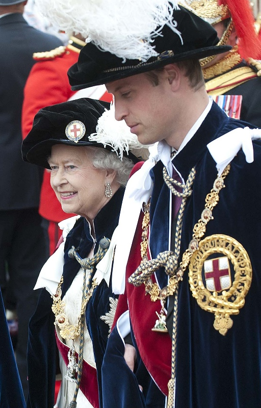 Britain's Queen Elizabeth II (L) walks in procession with Britain's Prince William, Duke of Cambridge, (R) during the annual parade for members of the Order of the Garter at Windsor Castle in Berkshire, west of London on June 17, 2013. The Queen was joined by members of the royal family for the annual Order of the Garter service. The Order of the Garter is the pinnacle of the UK honours system with appointments of Knights of the Garter a perogative of the Queen, and a gift that is made without consulting ministers. Prince Charles, Prince of Wales and Prince William are both knights of the order. AFP PHOTO / POOL / MURRAY SANDERS (Photo credit should read MURRAY SANDERS/AFP/Getty Images)