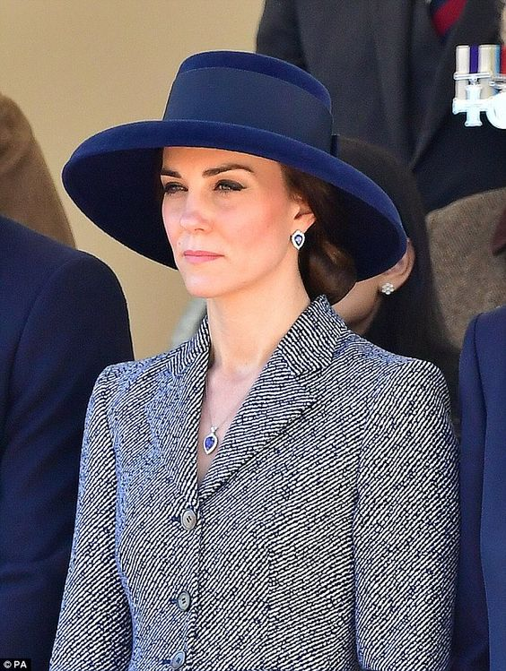 The Duchess of Cambridge, 35, recycled a favourite Michael Kors coat for the THIRD time as she joins the royals to unveil a new war memorial in London Photo (C) GETTY IMAGES