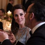 The Duchess of Cambridge listened to French actor Jean Reno at the dinner in the elegant 18th century residences ballroom