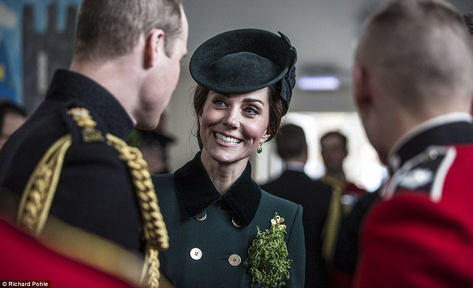 The Duke and Duchess of Cambridge talk with soldiers of the 1st Battalion Irish Guards following their St Patrick's Day Parade